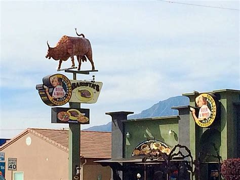 restaurant sign featuring bull s large
