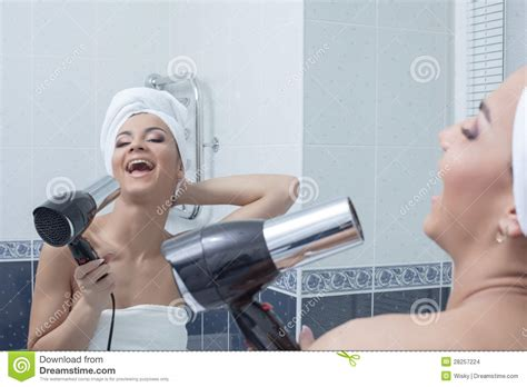 singing in bathroom happy young woman singing in bathroom stock images image