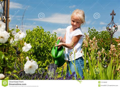 girl watering flowers little girl watering flowers stock photo image 12746522