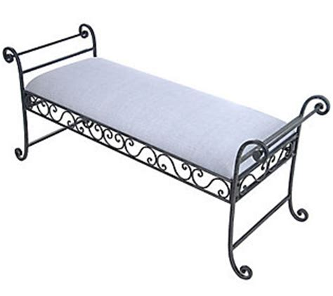 wrought iron scroll design bench with cushion by valerie