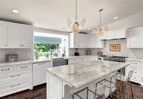 Kitchen Island With Sink And Dishwasher And Seating white kitchen cabinets with marble countertops
