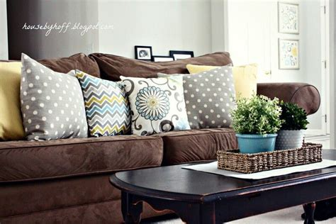 mixing throw pillows brown couch living room dark brown