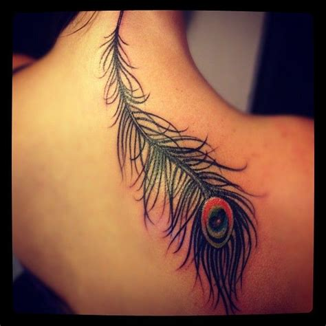 feather tattoo stomach thigh peacock bird art feather stomach tattoo design idea