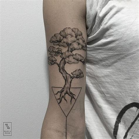 tattoos elegantly combine delicate natural subjects with