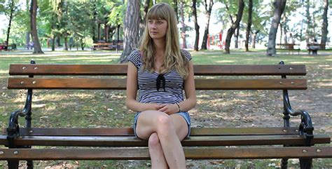 girl sitting on a bench beautiful girl sitting on the bench and waiting by