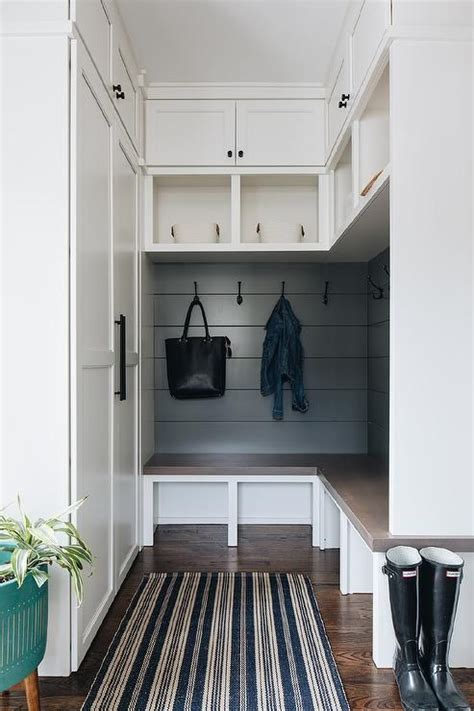 small  shaped mudroom bench features black shiplap trim