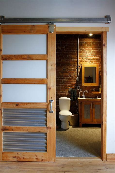 sliding bathroom barn door 15 sliding barn doors that bring rustic beauty to the bathroom