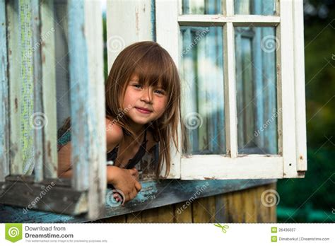 little girl house little girl looks out the window rural house royalty free stock photography image