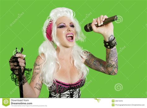 beautiful tattooed women beautiful tattooed singing with microphone