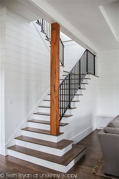 stairs to the basement open staircase wood planked walls stained and painted stairs metal