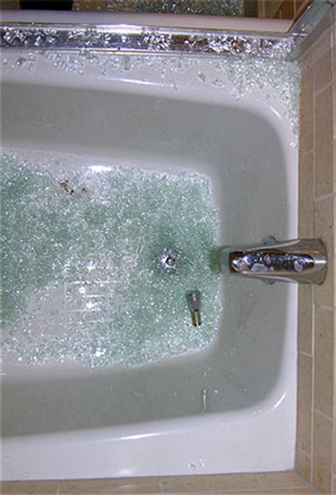 tempered glass shower door shattered photo of broken glass in tub after shower door shattered