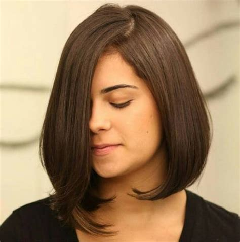 medium hairstyles that are angled towards the face layered bob toward face and stacked in back hairstyle