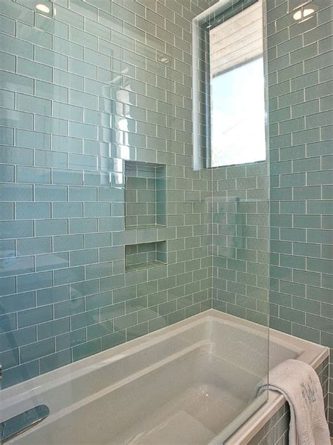 Gorgeous shower tub combo with walls and bath surround tiled in blue glass subway tile home