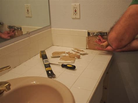 how to remove floor tiles in bathroom simple bathroom vanity removal hah