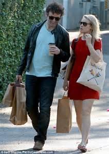 Rachel McAdams looks stunning in short scarlet mini dress as she shops with boyfriend Michael