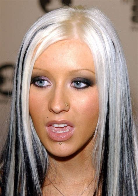 brunette to platinum streaks christina aguilera s platinum blonde hair with black