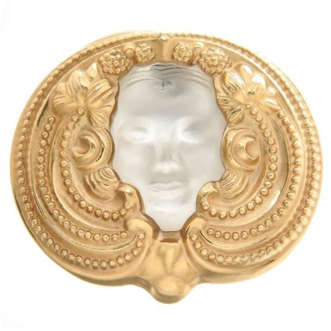 Metal Brooch lalique masque de femme gilt metal brooch at 1stdibs