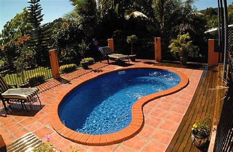 appealing kidney shaped  ground pool  orange decks