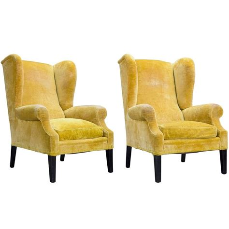 yellow armchairs pair of yellow velvet wingback armchairs circa 1950 at