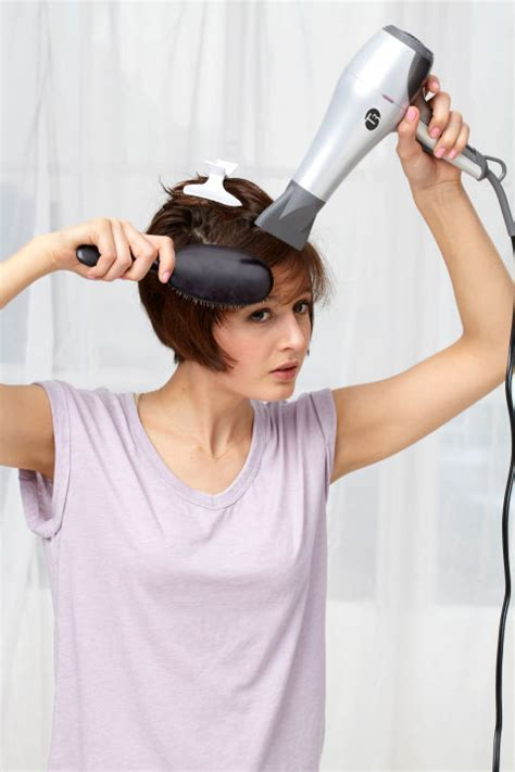 how to section your hair for blow drying blow drying tips how to blow dry your hair like a pro
