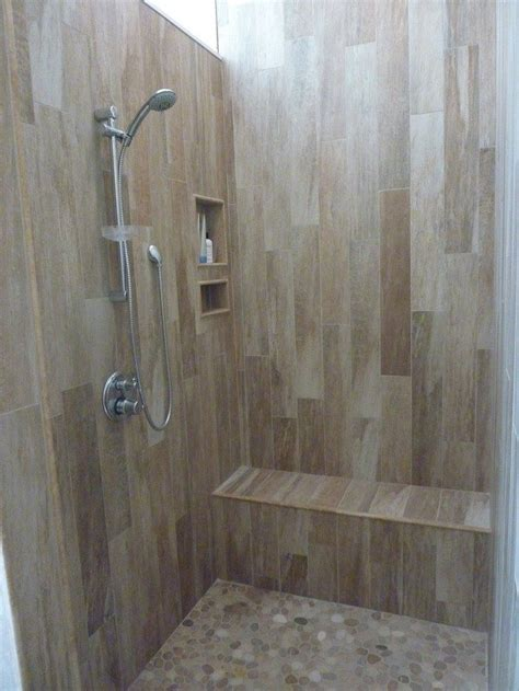Shower Walls Options by Rev Your Bathroom With A Pebble Shower Floor Diy