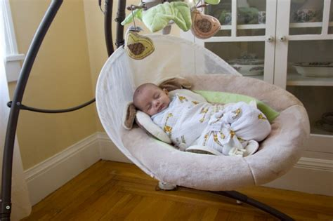 using a swing for baby to sleep sleeping the daily swaddle