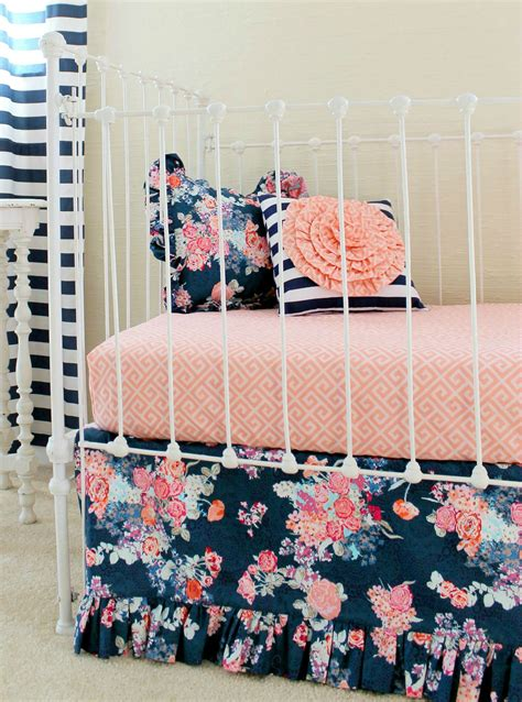 coral and navy bedroom this bold navy and coral bedding by lottiedababy is sure
