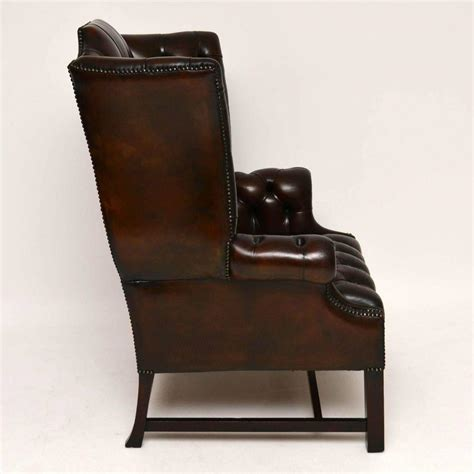 antique buttoned leather wing back armchair for sale