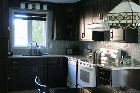 black kitchen cabinets with white appliances decor