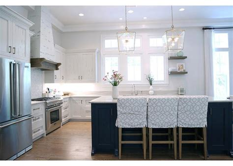 White Pecky Cypress Kitchen Cabinets With Navy Blue Island | pecky cypress kitchen cabinets white and navy blue