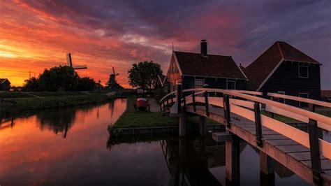 sunset farm  netherlands house  wooden bridge channel