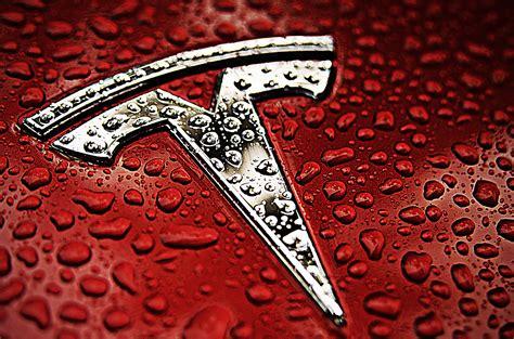 tesla motors emblem tesla logo tesla car symbol meaning and history car