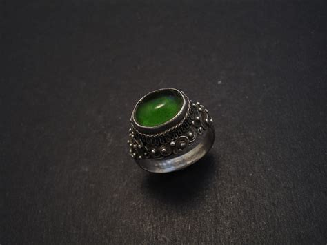 vientiane silver ring with green glass christopher