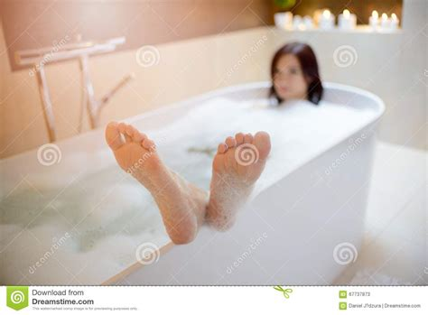 feet in bathtub washing of feet by soap stock image cartoondealer com 22404769