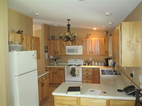 what goes where in kitchen cabinets what paint color goes well with hickory cabinets