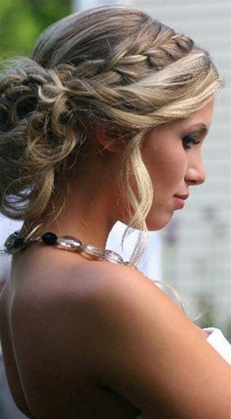 formal hairstyles messy bun with braid hair updo bun and side plait wedding flowers hair