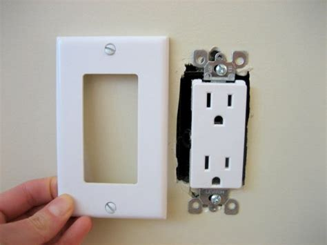 electrical outlet covers child proof your electrical outlets to cut energy costs squawkfox
