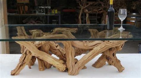 wine barrel coffee table glass top upcycled wood turning salvaged wood into decor by wine country craftman