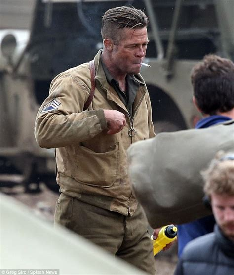 brad pitt smokes on set of new movie fury amid angelina