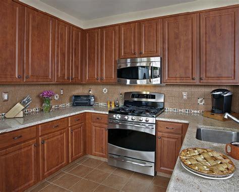 quartz colors work   cherry cabinets