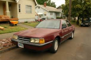 parked cars 1990 dodge monaco le