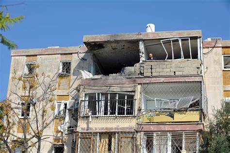 house builder file apartment building in the israeli town of kiryat malachi that took a direct hit from a
