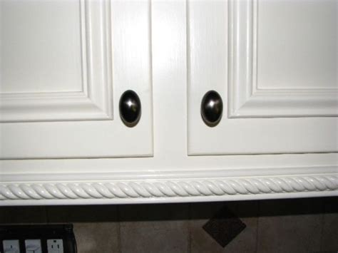 How To Add Moulding To Kitchen Cabinets Add Trim To Dress Up Kitchen Cabinet Doors House