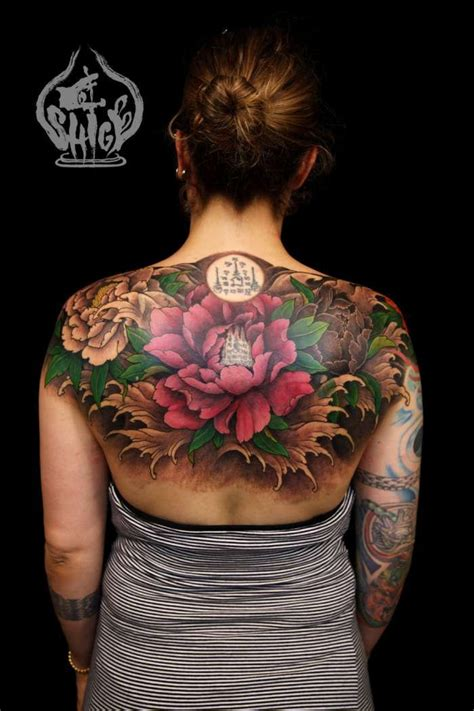 flower back tattoos by shige tattoos flowers