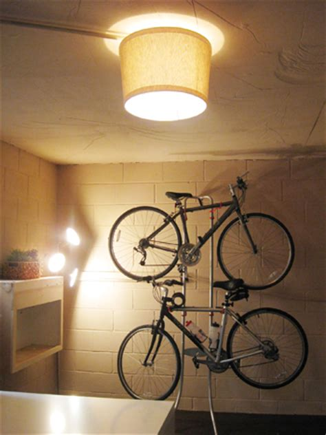 bare light bulb cover basement update hanging our bikes and adding a shade