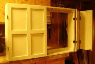 Bi fold doors on a large cabinet tv cover wall mounted sized to y