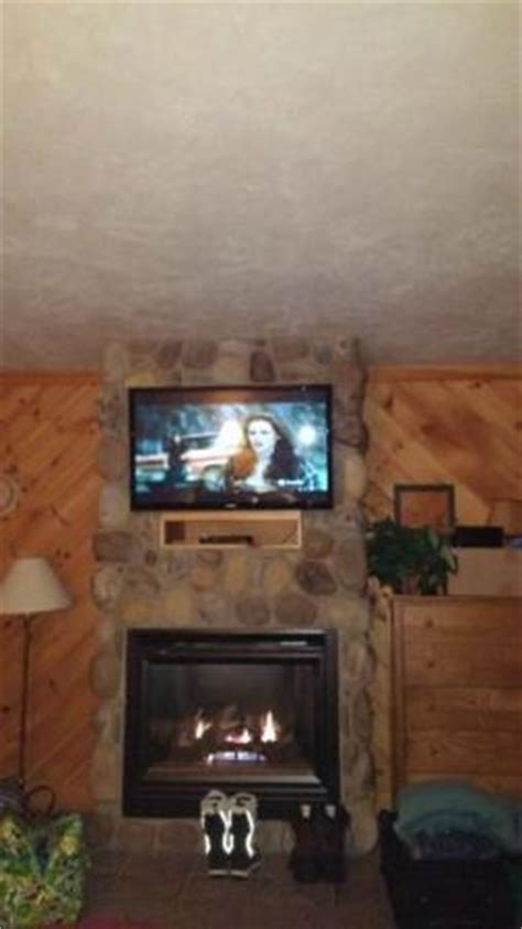 Flat Screen Tv Mounted Fireplace by Flat Screen Tv Mounted Above A Beautiful Gas Fireplace