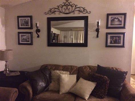 pictures for a living room wall wall in living room mirror frame sconces and metal decor d my