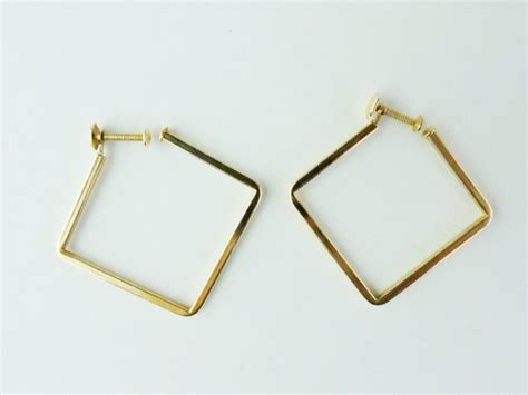 Square Earrings a pair of 14 karat yellow gold square earrings by birks