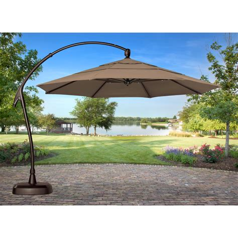 11 Cantilever Patio Umbrella With Base Treasure Garden 11 Ft Cantilever Offset Patio Umbrella With Base Patio Umbrellas At Hayneedle